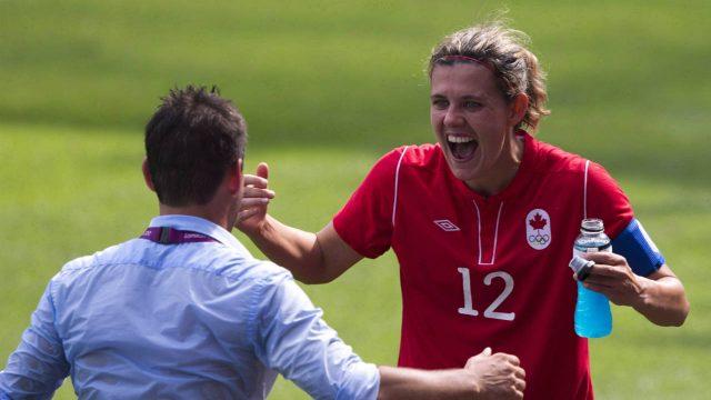 Canada-forward-Christine-Sinclair-(right)-celebrates-with-coach-John-Herdman.-(Frank-Gunn/CP)