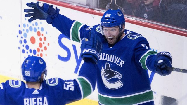 Vancouver-Canucks-left-wing-Thomas-Vanek-(26)-celebrates-his-goal-with-teammate-Alex-Biega-(55)-during-second-period-NHL-action-against-the-Montreal-Canadiens-in-Vancouver,-Tuesday,-Dec.-19,-2017.-(Jonathan-Hayward/CP)