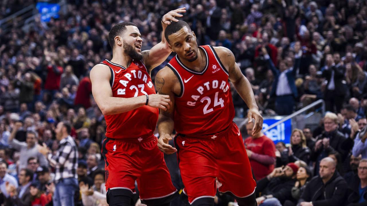 Toronto-Raptors-guard-Fred-VanVleet-(23)-congratulates-teammate-Norman-Powell-(24)-during-second-half-NBA-basketball-action-against-the-Minnesota-Timberwolves-in-Toronto-on-Tuesday,-Jan.-30,-2018.-(Christopher-Katsarov/CP)