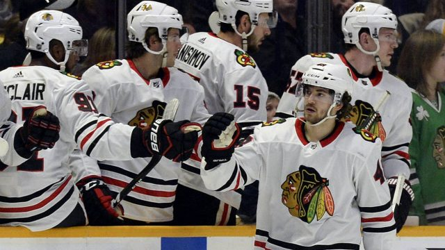 Chicago-Blackhawks-left-wing-Vinnie-Hinostroza-(48)-is-congratulated-after-scoring-a-goal-against-the-Nashville-Predators-during-the-second-period-of-an-NHL-hockey-game-Tuesday,-Jan.-30,-2018,-in-Nashville,-Tenn.-(Mark-Zaleski/AP)