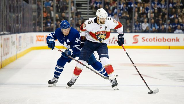 Florida-Panthers-defenceman-Aaron-Ekblad-(5)-moves-the-puck-past-Toronto-Maple-Leafs-defenceman-Morgan-Rielly-(44).-(Christopher-Katsarov/CP)