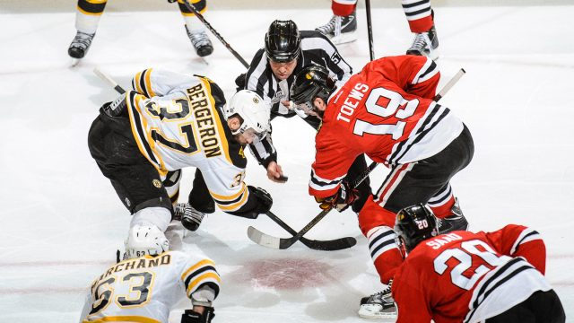 Jay-Sharrers-drops-the-puck-for-Patrice-Bergeron-and-Jonathan-Toews-during-Game-2-of-the-2013-Stanley-Cup-Final.