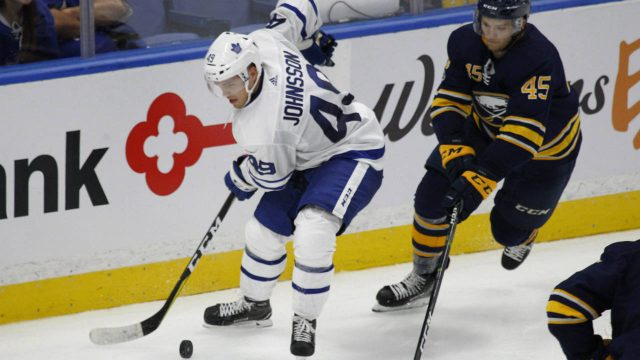 Buffalo-Sabres-defenceman-Brendan-Guhle-(45)-chases-Toronto-Maple-Leafs-forward-Andreas-Johnsson-(49)-during-the-third-period-of-a-pre-season-NHL-hockey-game,-Saturday-Sept.-23,-2017,-in-Buffalo,-N.Y.-(Jeffrey-T.-Barnes/AP)