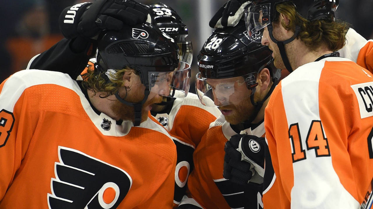 Philadelphia-Flyers'-Claude-Giroux,-second-from-right,-is-congratulated-by-teammates-Jakub-Voracek,-left,-Shayne-Gostisbehere-and-Sean-Couturier-(14)-after-scoring-a-goal-against-the-Montreal-Canadiens-during-the-second-period-of-an-NHL-hockey-game-Thursday,-Feb.-8,-2018,-in-Philadelphia.-(Derik-Hamilton/AP)