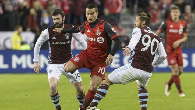 Toronto-FC's-Sebastian-Giovinco-(centre)-takes-the-ball-between-Colorado-Rapids'-Enzo-Martinez-(right)-and-Jack-Price-during-first-half-CONCACAF-Champions-League-Round-of-16-action-in-Toronto-on-Tuesday,-February-27,-2018.-(Chris-Young/CP)