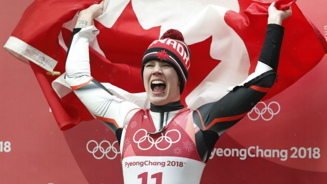 Third-placed-silver-medalist-Alex-Gough-of-Canada-waves-a-Canadian-flag-after-the-Women's-Luge-Singles-competition-at-the-Olympic-Sliding-Centre-during-the-PyeongChang-2018-Olympic-Games,-South-Korea,-13-February-2018.-EPA/JEON-HEON-KYUN