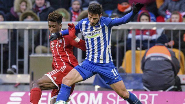 Bayern's-Kingsley-Coman,-left,-and-Hertha's-Mathew-Leckie-challenge-for-the-ball-during-the-German-Bundesliga-soccer-match-between-FC-Bayern-Munich-and-Hertha-BSC-Berlin-in-Munich,-southern-Germany,-Saturday,-Feb.-24,-2018.-(Matthias-Balk/dpa-via-AP)