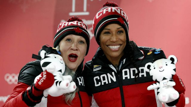 Driver-Kaillie-Humphries,-left,-and-Phylicia-George,-right,-of-Canada-celebrate-winning-the-bronze-medal-during-the-women's-two-man-bobsled-final-at-the-2018-Winter-Olympics-in-Pyeongchang,-South-Korea,-Wednesday,-Feb.-21,-2018.-(Andy-Wong/AP)