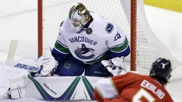 Vancouver-Canucks-goalie-Jacob-Markstrom-(25)-stops-a-shot-by-Florida-Panthers-defenceman-Aaron-Ekblad-(5)-in-the-second-period-of-an-NHL-hockey-game,-Saturday,-Dec.-10,-2016,-in-Sunrise,-Fla.-(Alan-Diaz/AP)