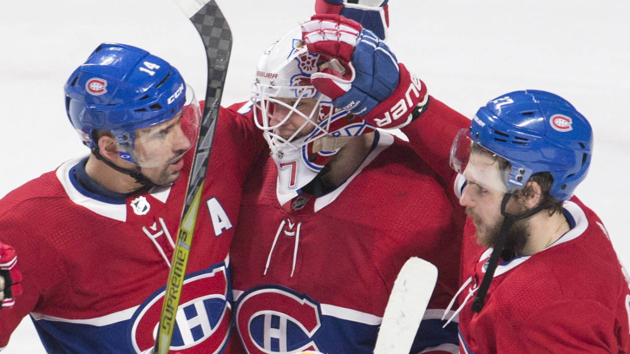 Montreal-Canadiens-goaltender-Antti-Niemi-(37)-celebrates-with-teammates-centre-Tomas-Plekanec-(14)-and-left-wing-Alex-Galchenyuk-(27)-after-defeating-the-Anaheim-Ducks-in-an-NHL-hockey-game-in-Montreal,-Saturday,-February-3,-2018.-(Graham-Hughes/CP)