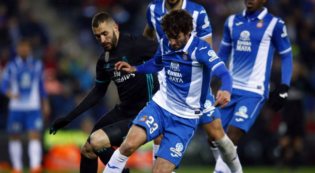 Real-Madrid's-Benzema,-left,-duels-for-the-ball-with-Espanyol's-Esteban-Granero-during-the-Spanish-La-Liga-soccer-match-between-Espanyol-and-Real-Madrid-at-RCDE-stadium-in-Cornella-Llobregat,-Spain,-Tuesday,-Feb.-27,-2018.-(Manu-Fernandez/AP)