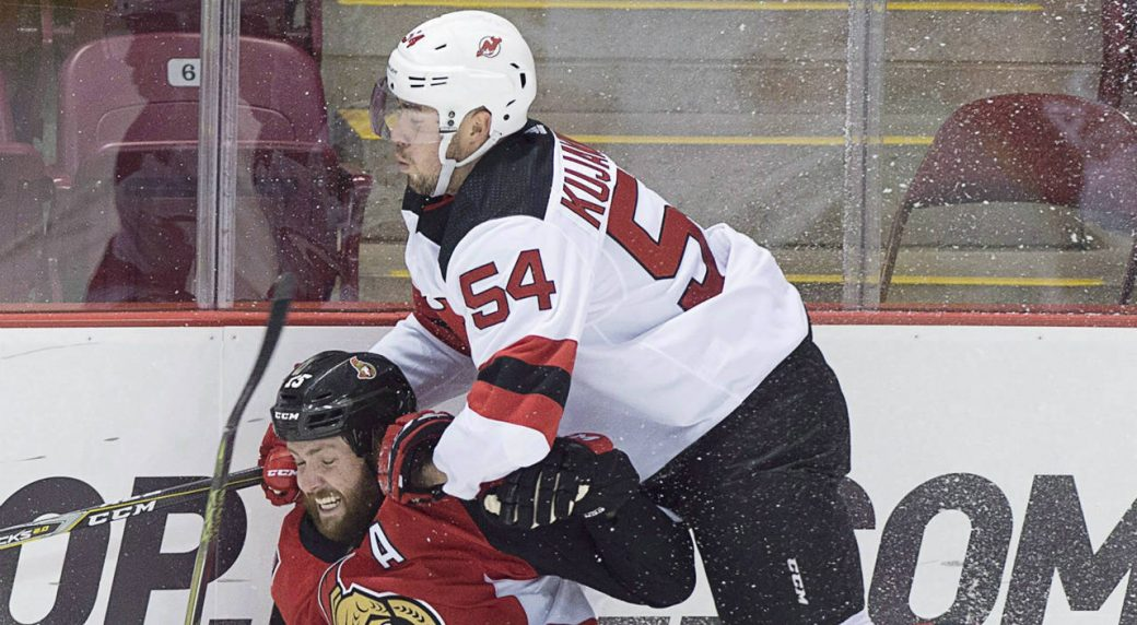 Ottawa-Senators-Zack-Smith-takes-a-hit-from-Ryan-Kujawinski,-right,-during-first-period-NHL-pre-season-hockey-action-in-Summerside,-P.E.I.-(Andrew-Vaughan/CP)