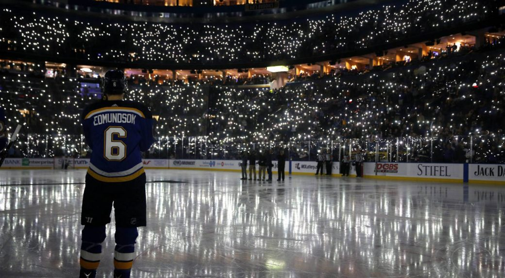 St.-Louis-Blues'-Joel-Edmundson-pauses-as-fans-uses-their-phones-to-light-up-Scottrade-Center-during-a-ceremony-as-part-of-a-league-wide-cancer-awareness-campaign.-(Jeff-Roberson/AP)