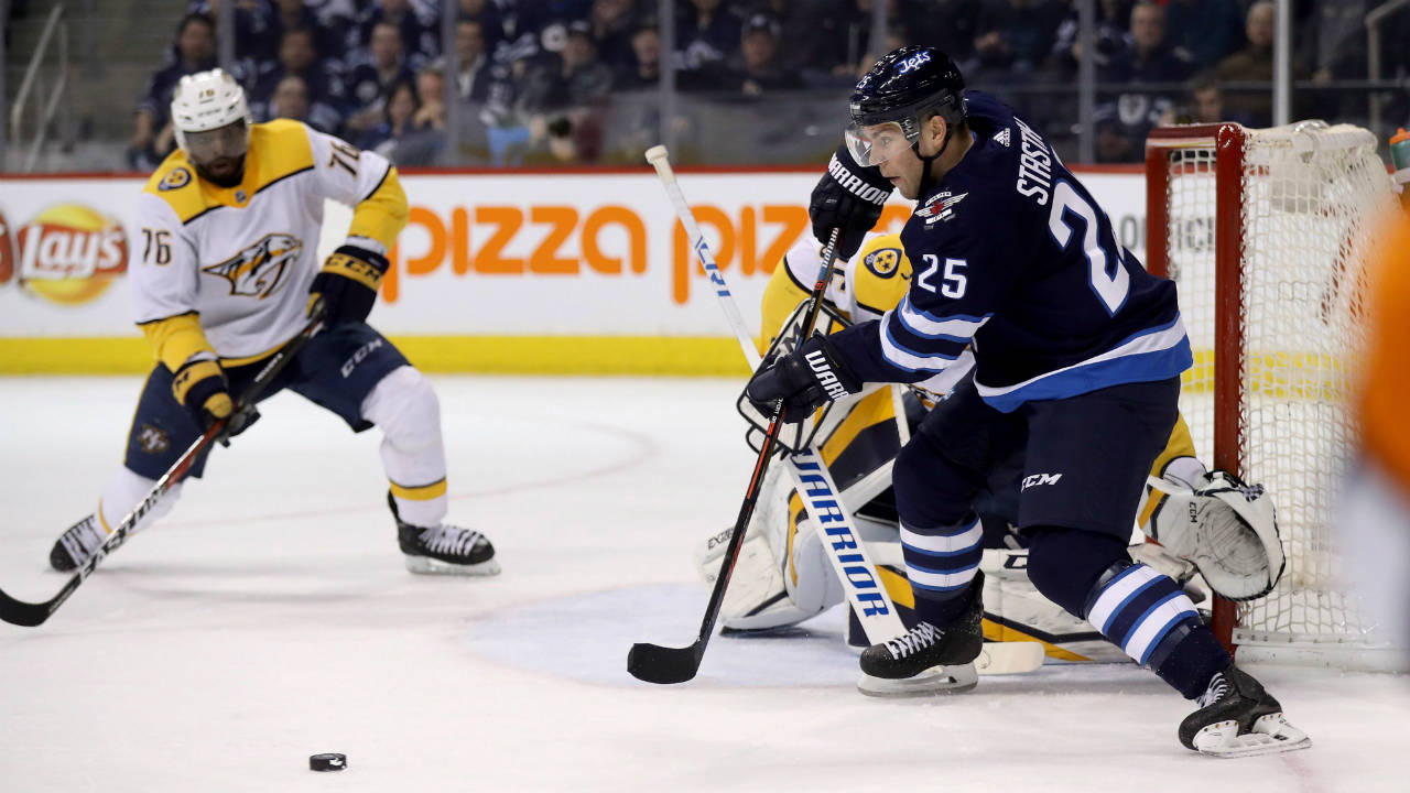 Winnipeg-Jets'-Paul-Stastny-(25)-passes-the-puck-as-Nashville-Predators'-goaltender-Pekka-Rinne-(35)-and-P.K.-Subban-look-on-during-second-period-NHL-hockey-action-in-Winnipeg,-Tuesday,-February-27,-2018.-(Trevor-Hagan/CP)