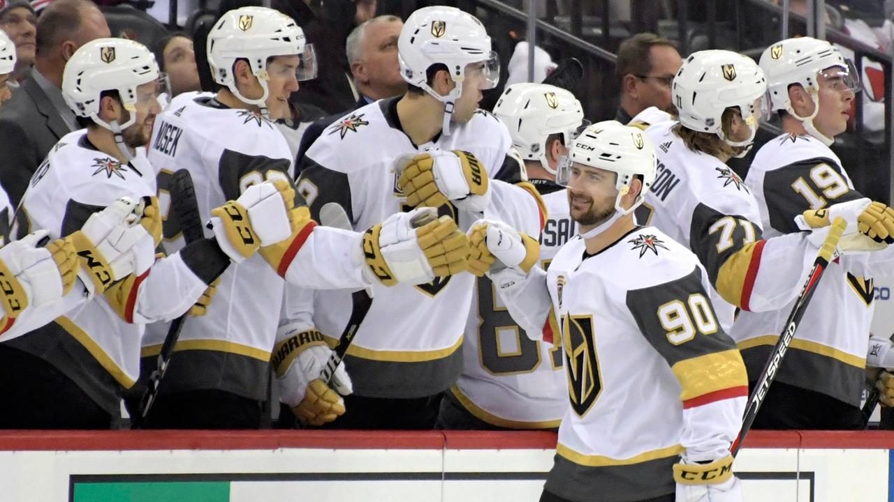 Vegas-Golden-Knights-left-wing-Tomas-Tatar-(90)-celebrates-his-goal-with-teammates-during-the-second-period-of-an-NHL-hockey-game-against-the-New-Jersey-Devils,-Sunday,-March-4,-2018,-in-Newark,-N.J.-(Bill-Kostroun/AP)
