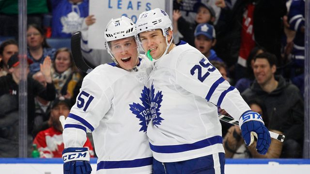 Toronto-Maple-Leafs-Jake-Gardiner-(51)-and-James-Van-Riemsdyk-(25)-celebrate-a-goal-during-the-first-period-of-an-NHL-hockey-game-against-the-Buffalo-Sabres