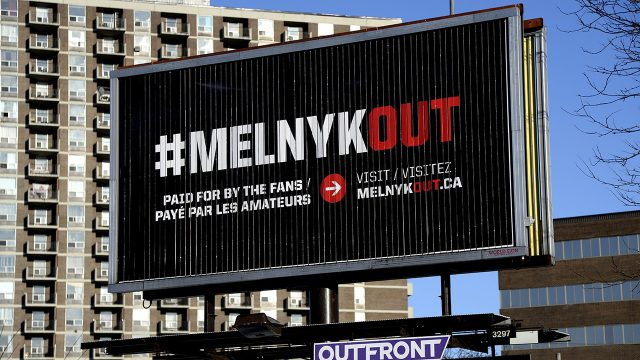A-billboard-reading-#Melnykout,-calling-for-the-Ottawa-Senators-owner-to-sell-the-team