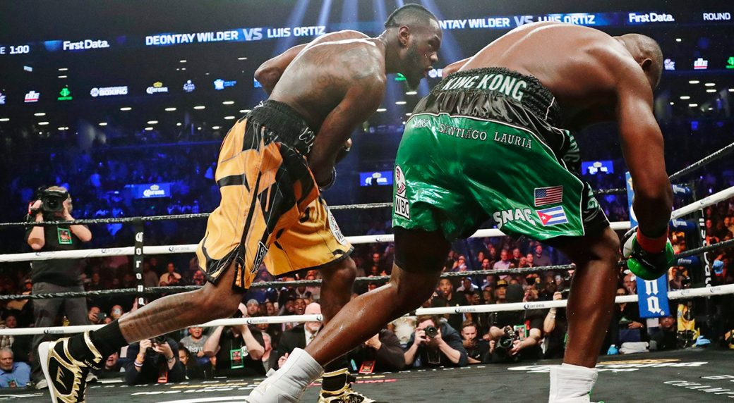 f43deb6518cd Deontay Wilder, left, follows through on a punch to Luis Ortiz during the  10th round of the WBC heavyweight championship. (Frank Franklin II/AP)