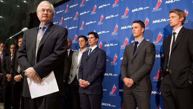 NHLPA-executive-director-Donald-Fehr-seen-here-addressing-journalists-as-he-stands-in-front-of-a-group-of-NHL-stars-back-in-2012.