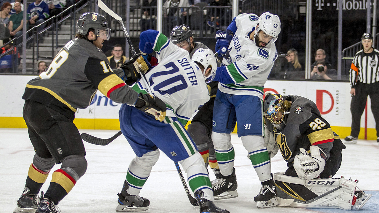 Vegas-Golden-Knights-goaltender-Marc-Andre-Fleury-stops-a-shot-by-Vancouver-Canucks-centre-Brandon-Sutter-during-the-first-period-of-an-NHL-game-in-Las-Vegas