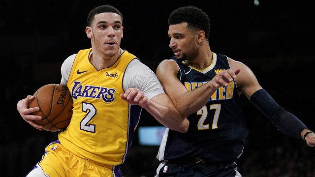 Los-Angeles-Lakers-guard-Lonzo-Ball,-left,-attempts-to-move-past-Denver-Nuggets-guard-Jamal-Murray-during-the-second-half-of-an-NBA-basketball-game-in-Los-Angeles,-Tuesday,-March-13,-2018.-Los-Angeles-defeated-Denver-112-103.-(Kelvin-Kuo/AP)