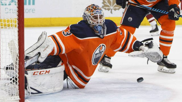 Edmonton-Oilers-goalie-Cam-Talbot-(33)-makes-the-save-against-the-Arizona-Coyotes-during-first-period-NHL-action-in-Edmonton,-Alta.,-on-Monday-March-5,-2018.-(Jason-Franson/CP)