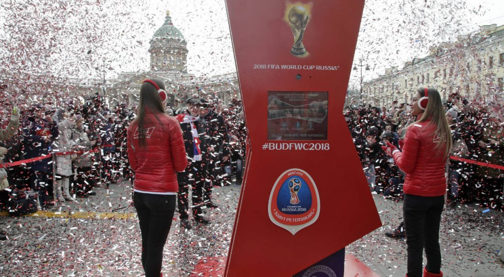 People-take-part-in-an-unveiling-ceremony-of-a-FIFA-World-Cup-2018-countdown-clock-to-mark-100-days-until-the-beginning-of-the-soccer-tournament,-in-St.Petersburg,-Russia,-Tuesday,-March-6,-2018.-(Dmitri-Lovetsky/AP)