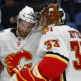 Calgary-Flames-TJ-Brodie-(7)-and-goalie-David-Rittich-(33)-celebrate-a-5-1-victory-over-the-Buffalo-Sabres-following-the-third-period-of-an-NHL-hockey-game,-Wednesday,-March.-7,-2018,-in-Buffalo,-N.Y.-(Jeffrey-T.-Barne/AP)