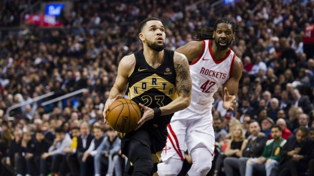 Toronto-Raptors-guard-Fred-VanVleet-(23)-drives-to-the-net-past-Houston-Rockets-centre-Nene-Hilario-(42)-during-first-half-NBA-basketball-action-in-Toronto-on-Friday,-March-9,-2018.-(Christopher-Katsarov/CP)
