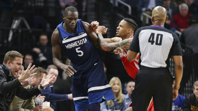 Minnesota-Timberwolves-centre-Gorgui-Dieng-(5)-is-pushed-by-out-of-bounds-by-Houston-Rockets-forward-Gerald-Green-(14)-after-Dieng-had-caused-Houston's-Chris-Paul-(3)-to-fall-during-the-fourth-quarter-of-an-NBA-basketball-game-Sunday,-March-18,-2018,-in-Minneapolis.-Green-was-ejected.-The-Rockets-defeated-the-Timberwolves-129-120.-(Andy-Clayton-King/AP)