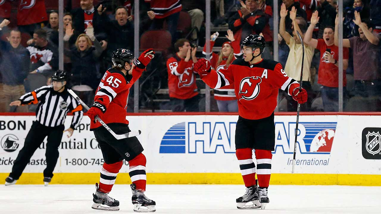 New-Jersey-Devils-left-wing-Taylor-Hall-(9)-is-congratulated-by-Devils-defenceman-Sami-Vatanen-(45)