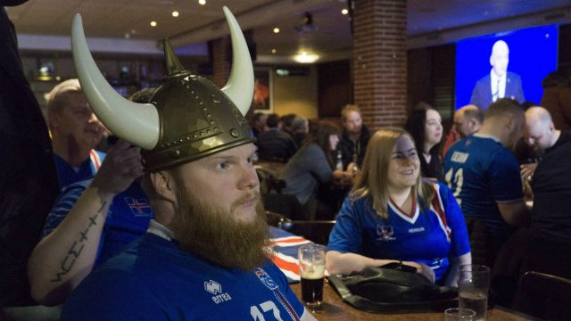 Iceland-soccer-fans-watch-the-2018-World-Cup-draw-from-a-sports-bar-in-Reykjavik,-Sunday,-Nov.-26,-2017.Iceland-is-the-smallest-nation-ever-to-qualify-for-the-World-Cup-with-the-finals-next-year-in-Russia,-being-drawn-in-the-tricky-Group-D-with-Argentina,-Croatia-and-Nigeria.-(David-Keyton/AP)