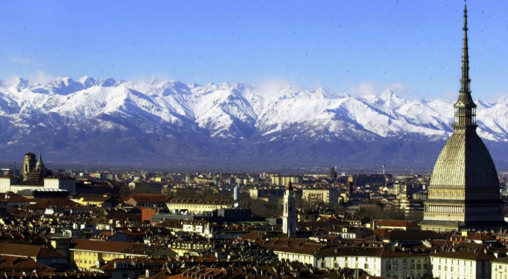 A-view-of-Turin,-Italy,-with-the-main-city-landmark,-the-Mole-Antonelliana,-at-right,-and-the-Alps-in-background-are-seen-in-this-December-2005-photo.-Milan-and-Turin-are-in-discussions-with-the-Italian-Olympic-Committee-over-a-possible-bid-for-the-2026-Winter-Games.-Turin-Mayor-Chiara-Appendino-sent-a-letter-of-interest-to-CONI-on-Sunday-despite-divisions-in-her-own-party,-the-populist-5-Star-Movement,-on-a-candidacy.-(Massimo-Pinca/AP)