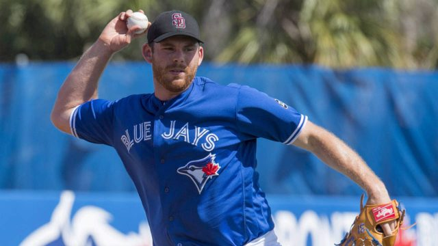 Toronto-Blue-Jays-starting-pitcher-Joe-Biagini-throws-out-Philadelphia-Phillies-Cameron-Rupp-at-first-base-during-first-inning-spring-training-action-in-Dunedin,-Fla.-on-Friday-February-23,-2018.-(Frank-Gunn/CP)