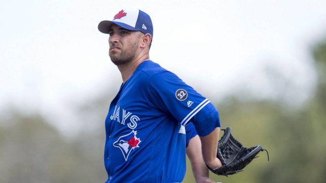 Toronto-Blue-Jays-starting-pitcher-Marco-Estrada-stretches-on-the-mound-in-between-pitches-to-the-New-York-Yankees-during-first-inning-exhibition-baseball-action-in-Dunedin,-Fla.-on-Tuesday,-Feb.-27,-2018.-(Frank-Gunn/CP)
