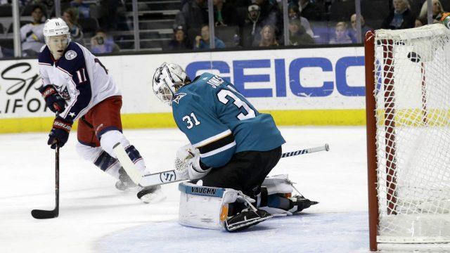 San-Jose-Sharks-goaltender-Martin-Jones-(31)-gives-up-a-goal-on-a-shot-from-Columbus-Blue-Jackets'-Nick-Foligno-as-the-Blue-Jackets'-Matt-Calvert-(11)-looks-on-during-the-first-period-of-an-NHL-hockey-game,-Sunday,-March-4,-2018,-in-San-Jose,-Calif.-(Marcio-Jose-Sanchez/AP)