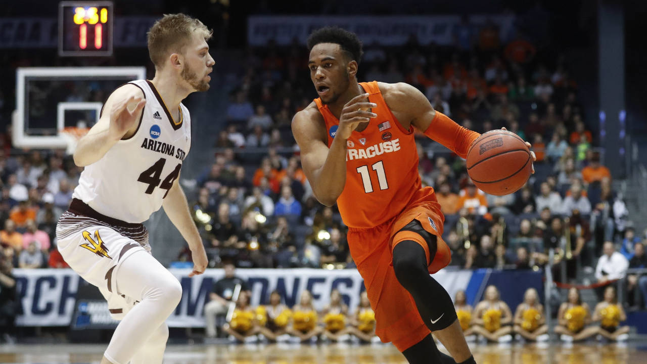 Syracuse's-Oshae-Brissett-(11)-drives-against-Arizona-State's-Kodi-Justice-(44)-during-the-second-half-of-a-First-Four-game-of-the-NCAA-men's-college-basketball-tournament-Wednesday,-March-14,-2018,-in-Dayton,-Ohio.-Syracuse-won-60-56.-(John-Minchillo/AP)