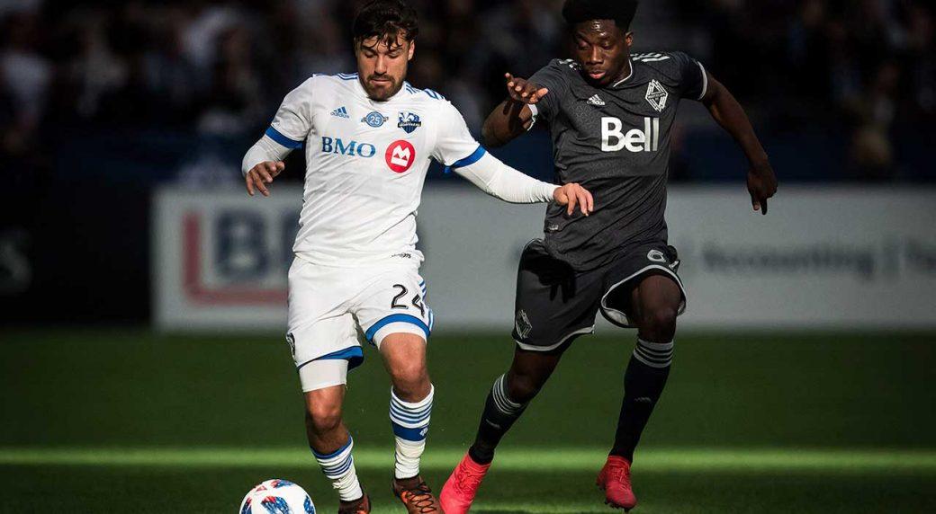Montreal-Impact's-Michael-Petrasso-and-Vancouver-Whitecaps'-Alphonso-Davies