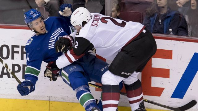 Arizona-Coyotes-defenceman-Luke-Schenn-(2)-puts-Vancouver-Canucks-defenceman-Michael-Del-Zotto-(4)-to-the-ice-during-second-period-NHL-action-in-Vancouver,-Wednesday,-March-7,-2018.-(Jonathan-Hayward/CP)