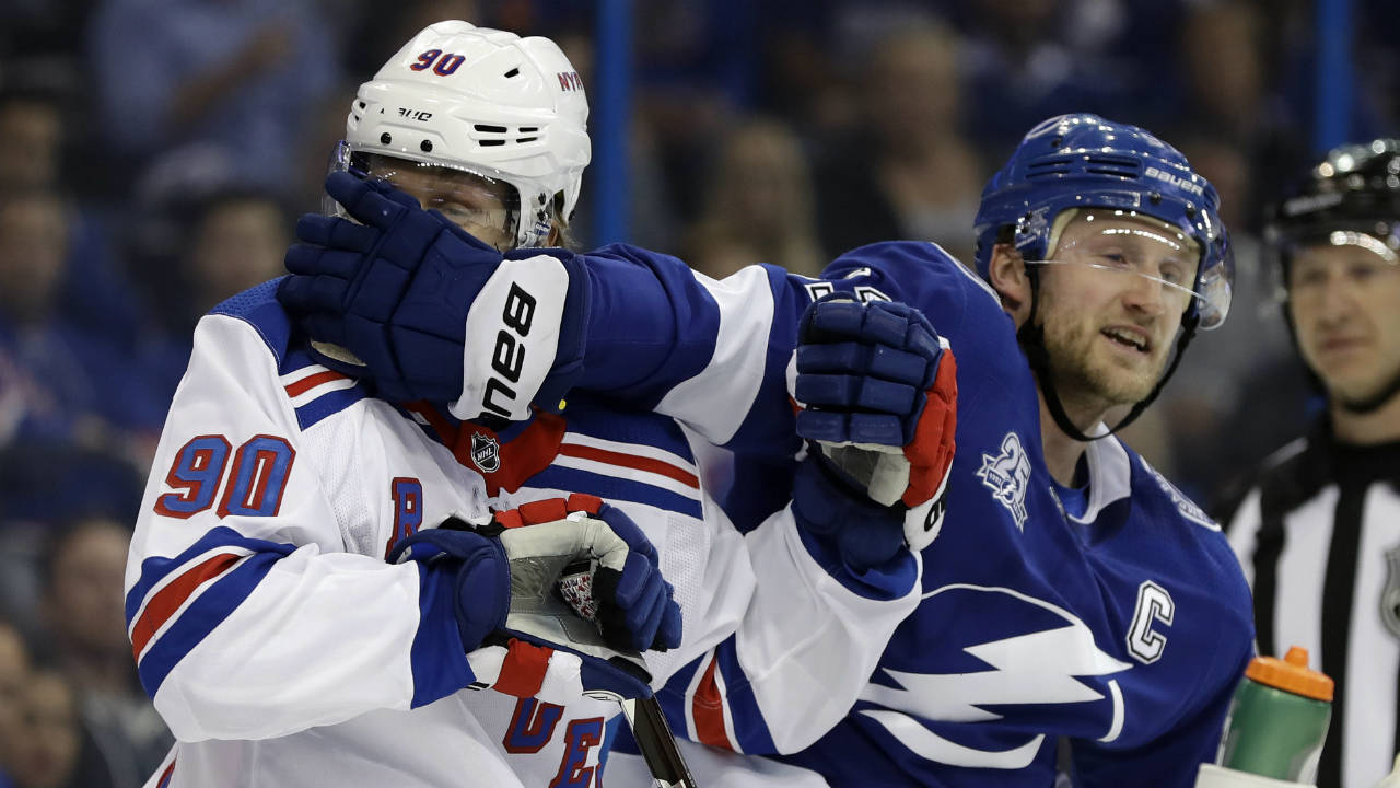 New-York-Rangers-centre-Vladislav-Namestnikov,-(90),-of-Russia,-gets-a-glove-in-his-face-from-former-teammate,-Tampa-Bay-Lightning-centre-Steven-Stamkos-(91),-during-the-first-period-of-an-NHL-hockey-game-Thursday,-March-8,-2018,-in-Tampa,-Fla.-(Chris-O'Meara/AP)