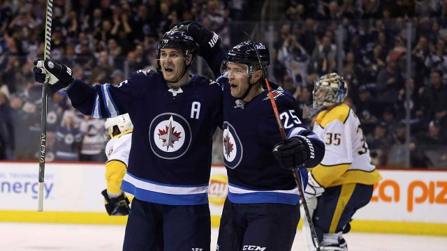 Winnipeg-Jets'-Mark-Scheifele-(55)-and-Paul-Stastny-(25)-celebrate-Scheifele's-goal
