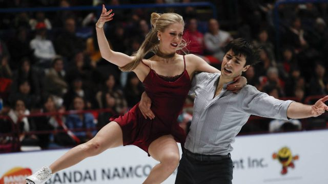 Kaitlyn-Weaver-and-Andrew-Poje-of-Canada-States-perform-during-pairs-Ice-dance-at-the-Figure-Skating-World-Championships-in-Assago,-near-Milan,-Saturday,-March-24,-2018.-(Antonio-Calanni/AP)