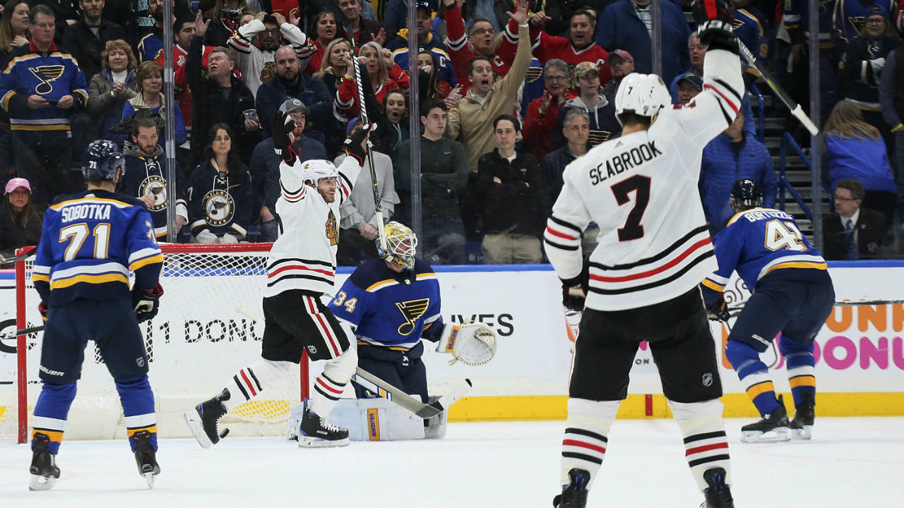 Chicago-Blackhawks-left-wing-Brandon-Saad,-second-from-left,-reacts-after-teammate-Duncan-Keith-scored-in-the-final-seconds-of-an-NHL-hockey-game-against-the-St.-Louis-Blues-on-Wednesday,-April-4,-2018,-in-St.-Louis.-(Chris-Lee/St.-Louis-Post-Dispatch-via-AP)