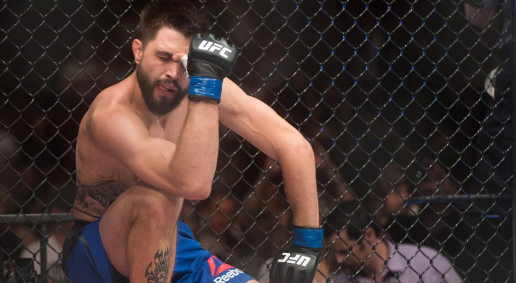 Carlos-Condit-welterweight-kneels-disappointed-after-losing-a-fight.