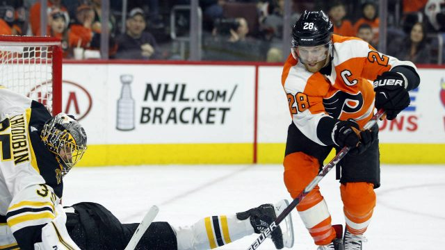 Philadelphia-Flyers'-Claude-Giroux,-right,-picks-up-the-loose-puck-in-front-of-Boston-Bruins-goalie-Anton-Khudobin-while-Adam-McQuaid-slides-head-first-into-the-net-during-the-second-period-of-an-NHL-hockey-game-Sunday,-April-1,-2018-in-Philadelphia,-PA.-(Tom-Mihalek/AP)