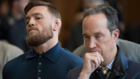 Conor-McGregor,-left,-stands-with-his-lawyer-Jim-Walden-during-his-arraignment-in-Brooklyn-Criminal-Court