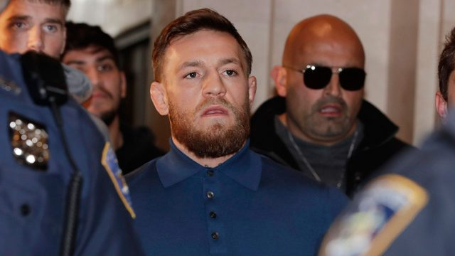 UFC-star-Conor-McGregor-seen-here-being-escorted-by-New-York-Court-Police-officers-after-a-hearing-at-the-Brooklyn-Criminal-Court-on-Friday,-April-6,-2018.