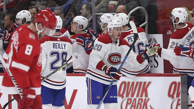 Montreal-Canadiens-left-wing-Nicolas-Deslauriers-(20)-is-congratulated-by-teammates-after-scoring-during-the-second-period-of-an-NHL-hockey-game-against-the-Detroit-Red-Wings,-Thursday,-April-5,-2018,-in-Detroit.-(Carlos-Osorio/AP)