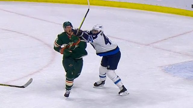 Winnipeg-Jets-defenceman-Joshua-Morrissey-gets-away-with-a-cross-check-to-the-face-of-Minnesota-Wild-forward-Eric-Staal.
