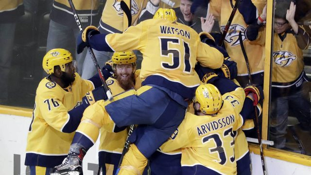 Nashville-Predators-players-celebrate-after-left-wing-Kevin-Fiala-scores-the-winning-goal-against-the-Winnipeg-Jets-during-the-second-overtime-in-Game-2-of-an-NHL-hockey-second-round-playoff-series,-Sunday,-April-29,-2018,-in-Nashville,-Tenn.-The-Predators-won-5-4-to-tie-the-series-1-1.-(Mark-Humphrey/AP)